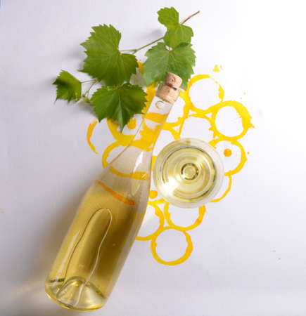 Wine goblet, bottle of wine and corks on picture painted with wine