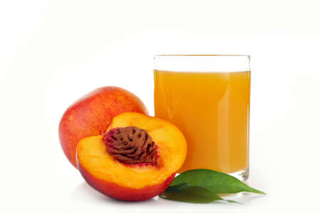 Peach juice in glass isolated on white