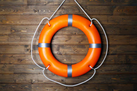 A life buoy on wooden wall Stock Photo