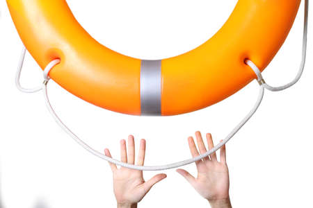 Human hands reaching for life preserver, close-up Stock Photo
