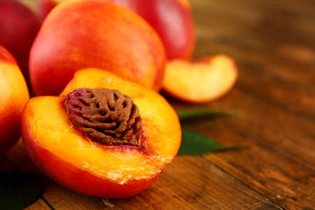 Fresh peaches on wooden background
