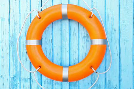 A life buoy on blue wooden background Stockfoto