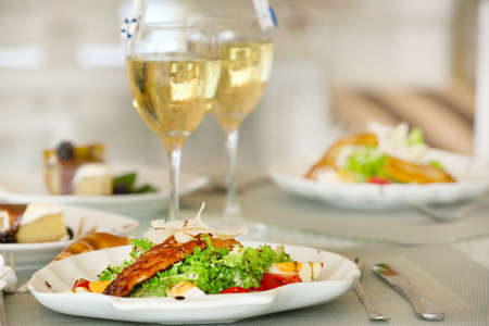 Tasty salad with served wine