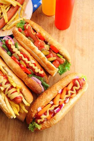 Fresh hot dogs on wooden background Standard-Bild