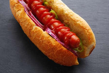 Fresh hot dog on dark grey background closeup