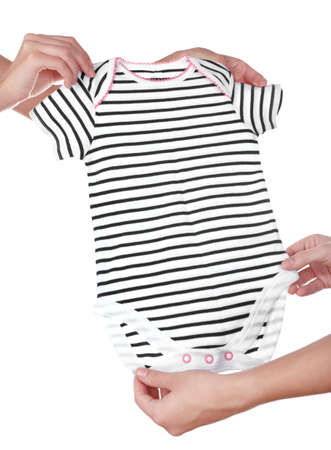 Concept of childish goods sale -one woman hand gives babys striped overall to another, isolated on white background