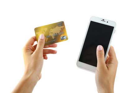 Female hands holding smartphone and credit card, isolated on white