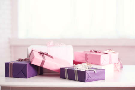 Cute gift boxes on white table Stock Photo