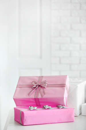 Decorated gift boxes on white brick wall background