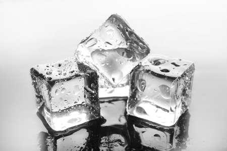 Shining ice cubes on liquid background