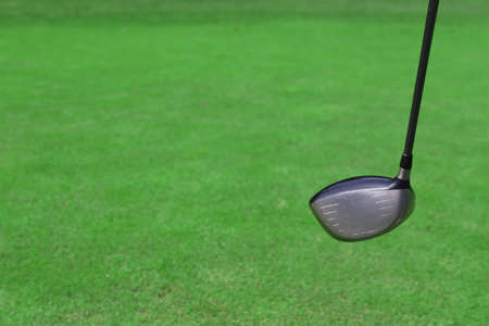 Expensive golf club on green luxury golf course, close up