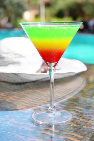 Cocktail on swimming pool background Stock Photo