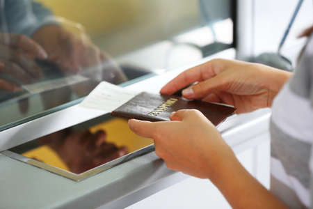 Airport Check-In Counters With Passengers  Stock Photo