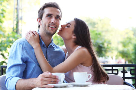 Young couple in street cafe  Stock Photo