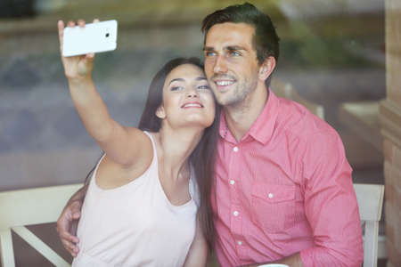 Young couple make selfie in cafe Stock Photo