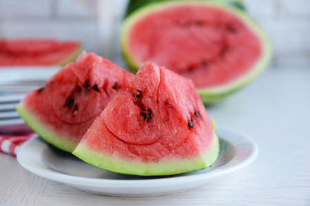 Sliced watermelons on table Stock Photo