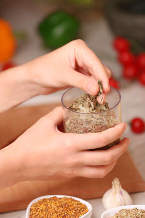Mint in the jar and variety of spices on the kitchen table Stock Photo