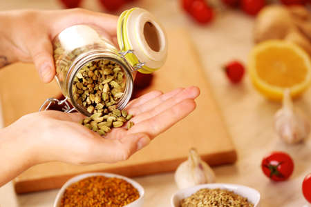 Cardamon and variety of spices on the kitchen table Stock Photo