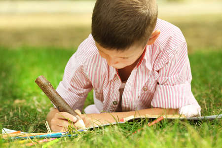 Little boy drawing in the park Stock Photo