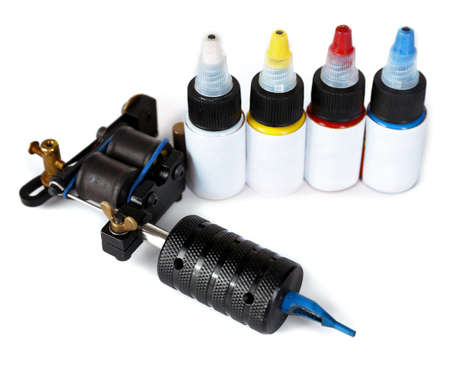 Tattoo machine with colourful ink isolated on white background