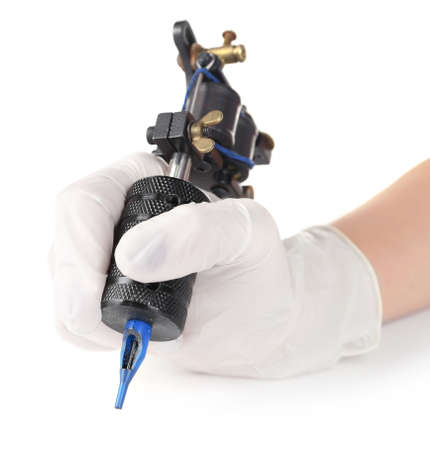 Tattoo machine in hand isolated on white background Stock Photo