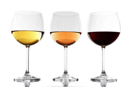 Glasses with white, rose and red wine isolated on white background 스톡 콘텐츠