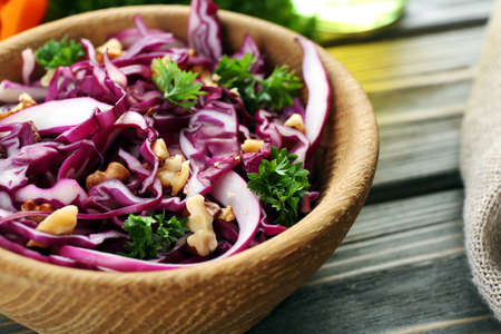 Red cabbage salad served on plate closeup 스톡 콘텐츠