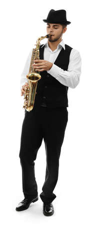 Happy saxophonist plays music on sax in elegant suit on white background Stock Photo