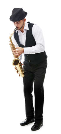 Happy saxophonist plays music on sax in elegant suit on white background Banque d'images