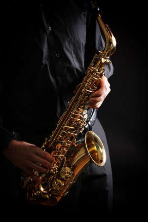 A man plays the saxophone close up