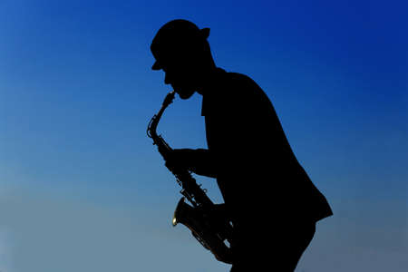 Saxophonist plays on the pier