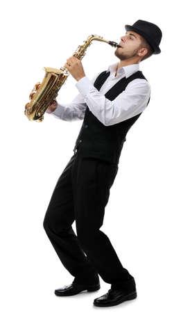 Happy saxophonist plays music on sax in elegant suit on white background Foto de archivo