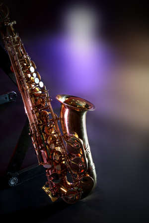 Beautiful golden saxophone on a scene, close up