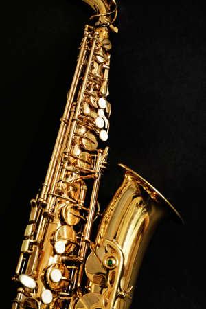 Beautiful golden saxophone on black background, close up Foto de archivo