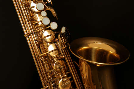 Beautiful golden saxophone on black background, close up 版權商用圖片