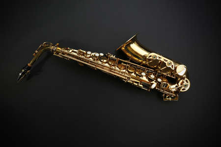 Beautiful golden saxophone on black background