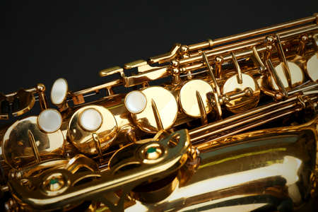 Beautiful golden saxophone on black background, close up Stock Photo
