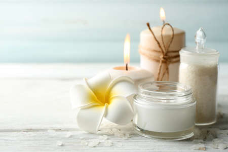 Spa coconut products on light wooden background