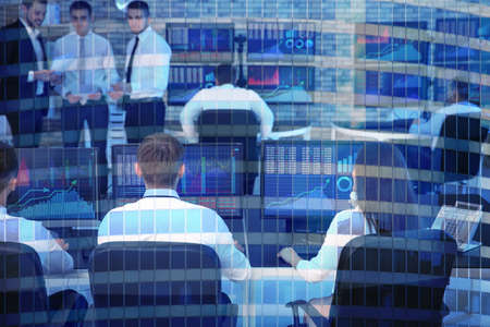 Double exposure of modern building and people working in office. Concept of financial trading 스톡 콘텐츠
