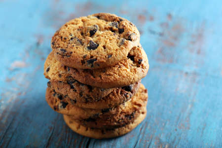 Close up focus view on cookies with chocolate crumbs on blue wooden table Stock Photo