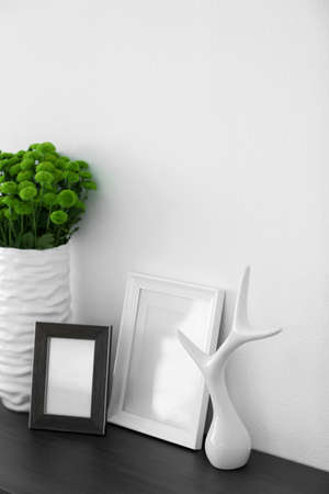 Beautiful green chrysanthemums in vase on commode in room