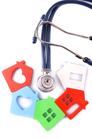 Concept of family medicine - colourful houses and stethoscope isolated on white background Stock Photo