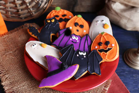 Halloween cookies on red plate Stock Photo