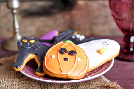 Halloween cookies on decorated table