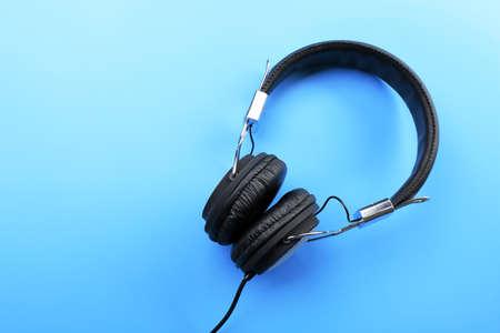 Black headphones on blue background Stock Photo