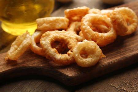 Chips rings with sauce and onion on cutting board Stock fotó