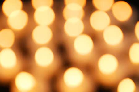Unfocused alight candles, close up Imagens