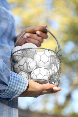 Eggs in basket in women hands outdoors