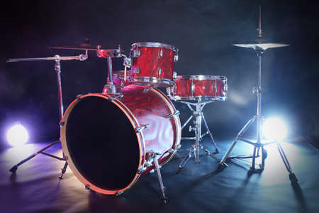 Drum set in smoke on a stage Banque d'images