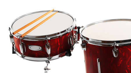 Red drums with drum sticks isolated on white background Stockfoto